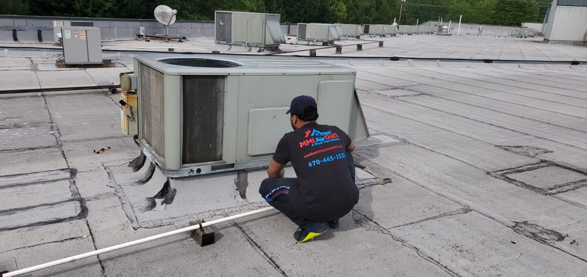 air duct repair and replacement worker
