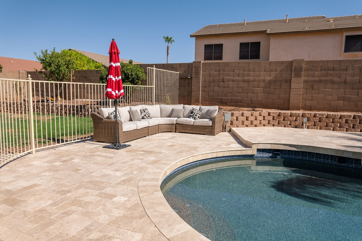 Pool Side Paved Deck with Patio Sofas in Sight